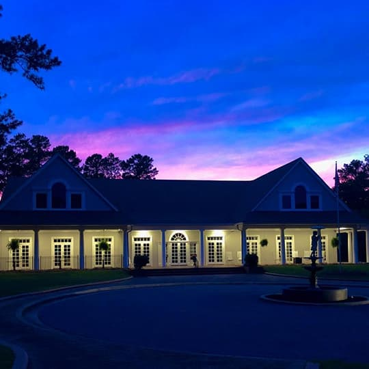 exterior of Jone Creek Clubhouse at night
